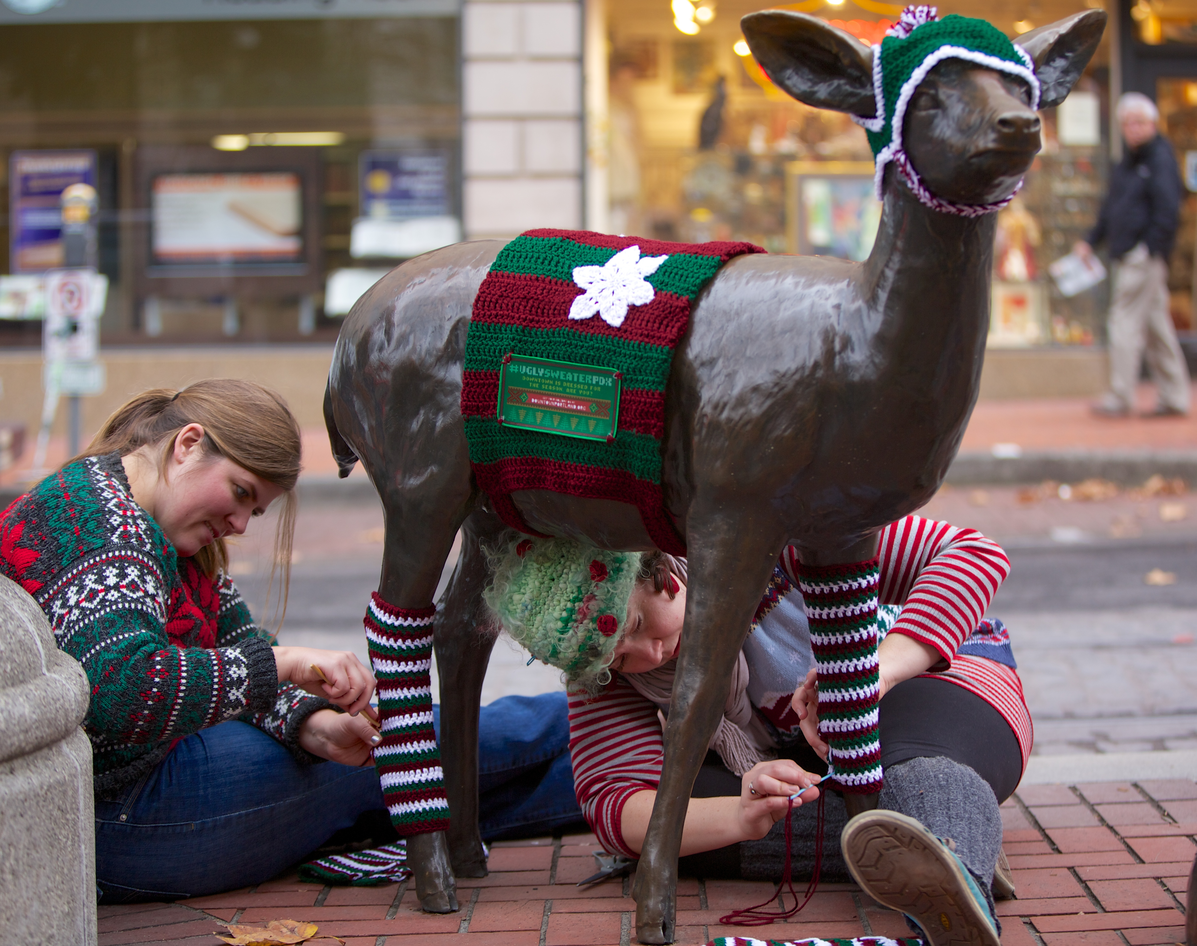 "Holiday crafters ""yarn bomb"" Portland statues"
