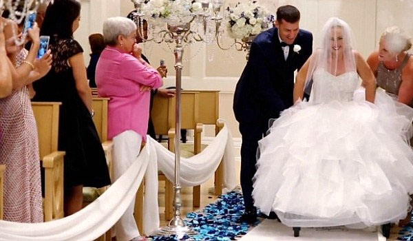 Bride triumphs over paralysis to walk down aisle on wedding day