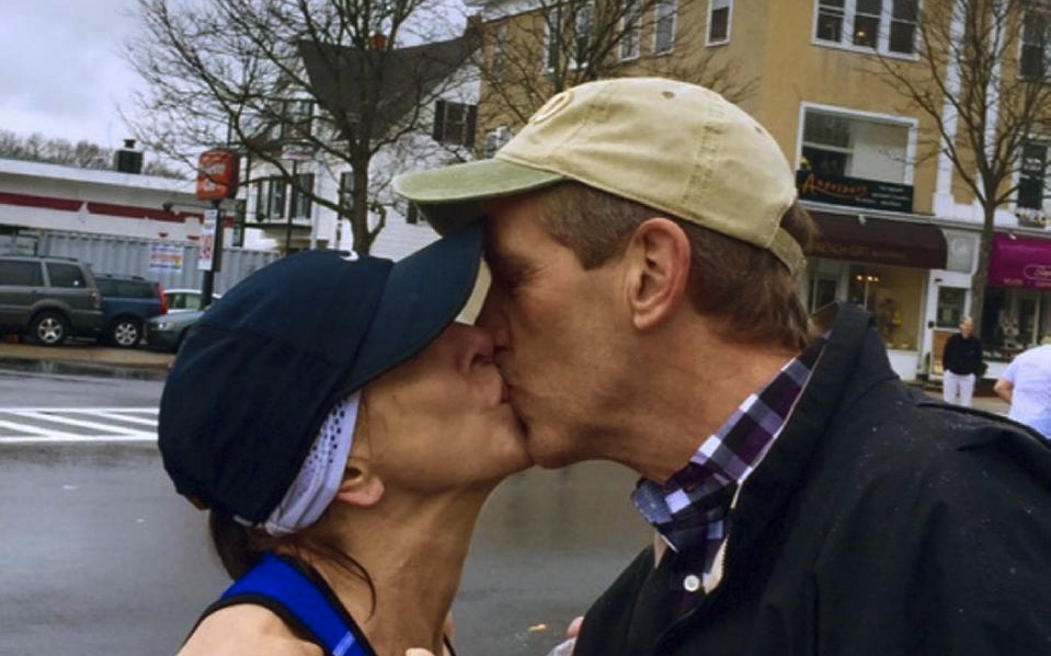Woman seeking stranger she kissed at Boston Marathon contacted by his wife