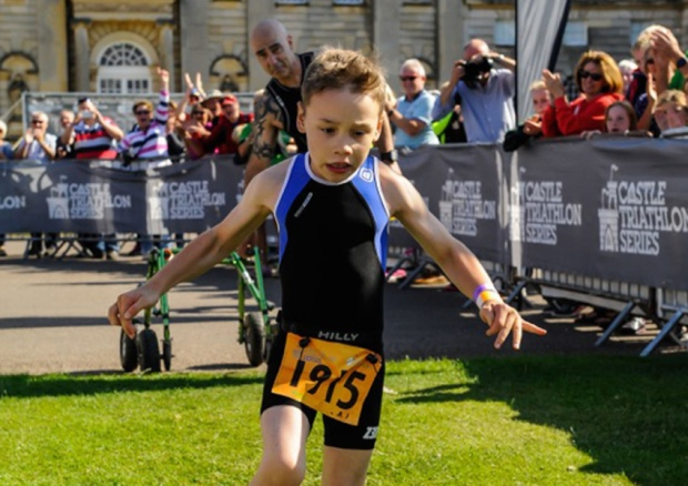 Despite obstacles, boy completes triathlon