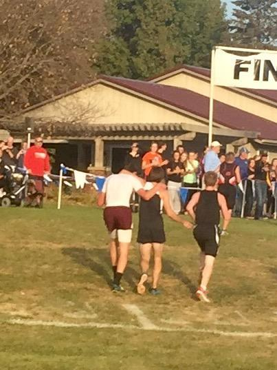 Cross country winner disqualified after helping other runner