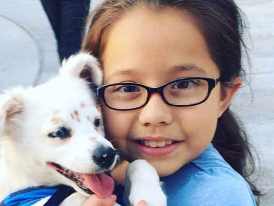 Deaf 10-year old girl teaches her puppy sign language