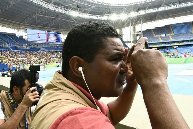 Blind Brazilian photographer Joao Maia takes pictures with his smartphone using the sound as a reference during the Rio 2016 Paralympic Games in Rio de Janeiro, Brazil on September 9, 2016. 41-year-old Maia lost his sight at age 28 due to an affection of the uvea. This is the first sportive event y covers as a photographer. / AFP / CHRISTOPHE SIMON        (Photo credit should read CHRISTOPHE SIMON/AFP/Getty Images)