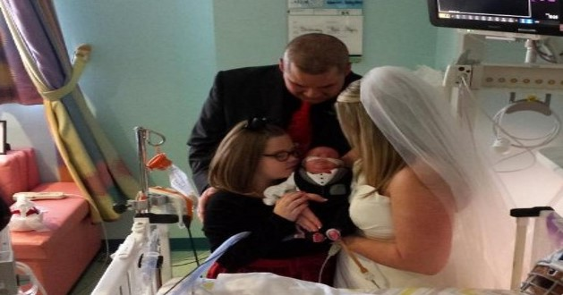 Preemie baby serves as parents' ring bearer in their hospital wedding