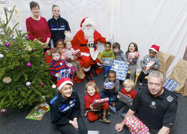 """Secret Santa"" partners with law enforcement officers to bless community"