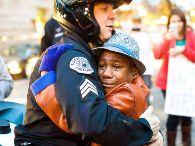 Portland photographer's Ferguson rally 'hug photo' depicts hope
