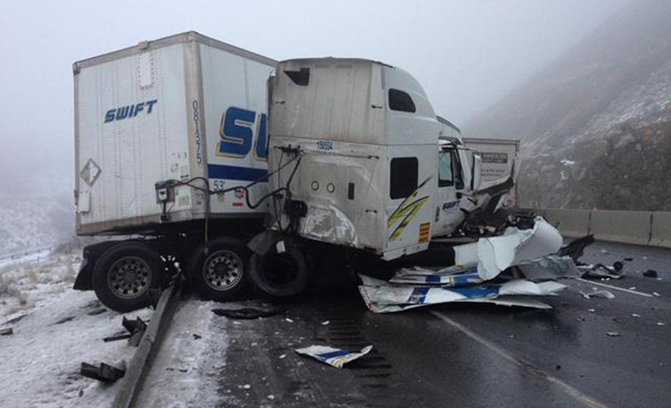 I-84 driver survives crash between semi-trucks uninjured