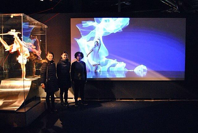 Members of Enra with their video at the Body World Exhibition in Berlin