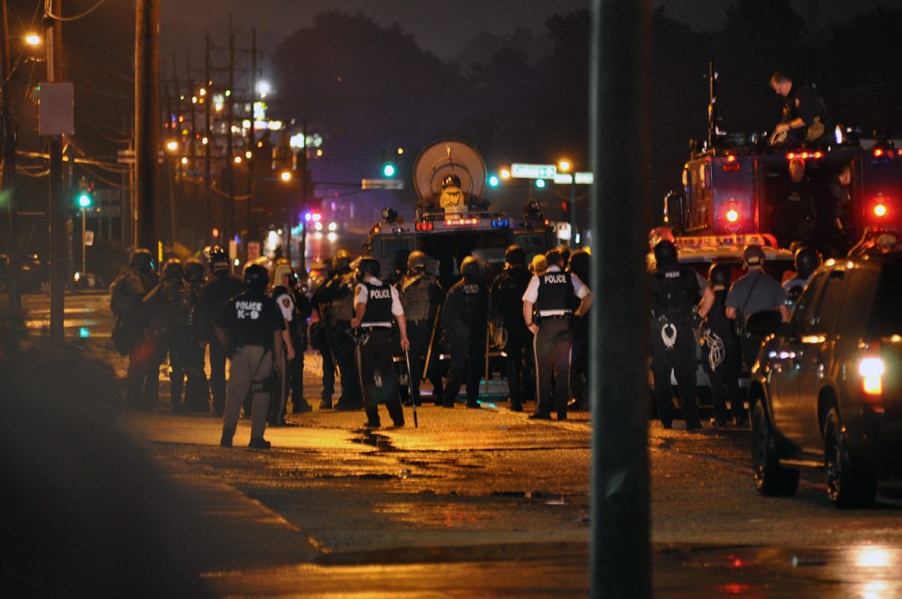 Two Ferguson officers survive shooting during protest