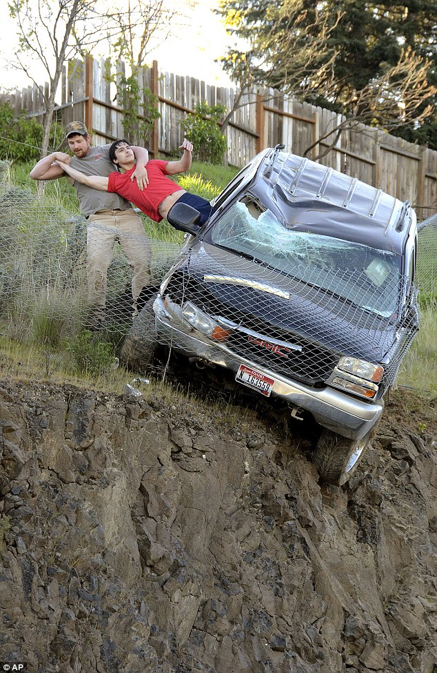 Man saves driver of car dangling over cliff