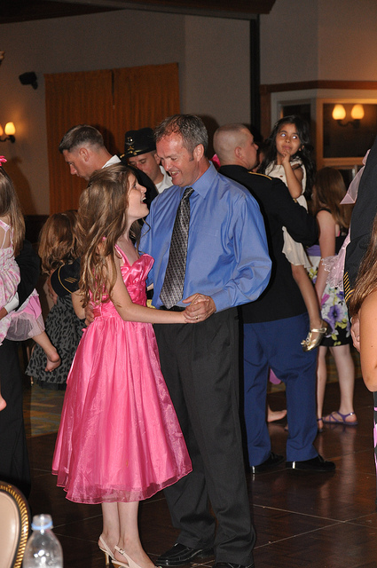 Father surprises daughter at school dance after nine-month deployment