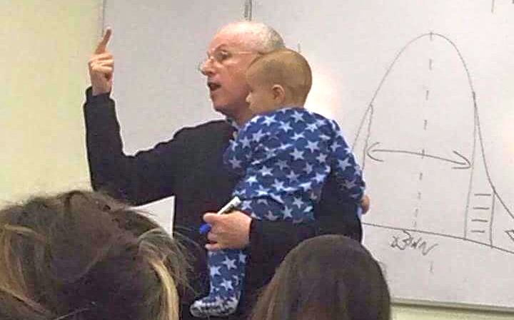Photo of professor holding student's baby goes viral