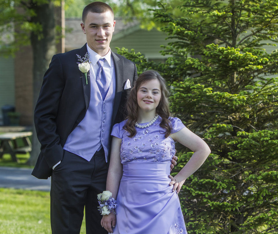 High school quarterback takes friend with Down syndrome to prom