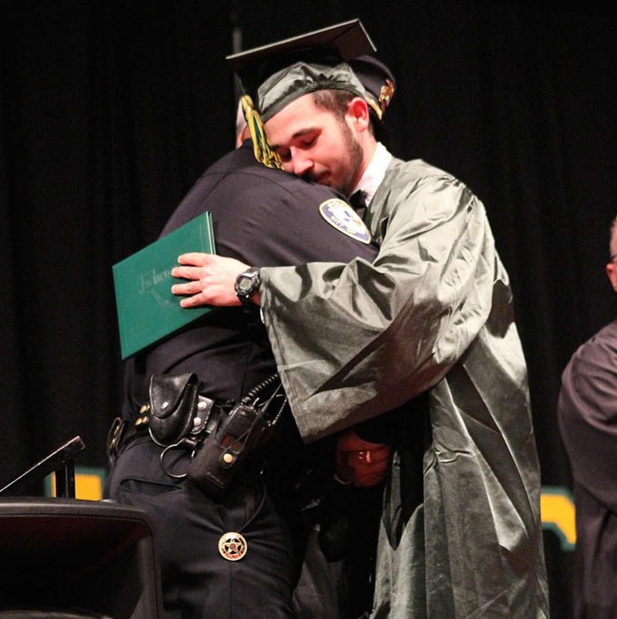 Police officer stands in for parents of high school graduate