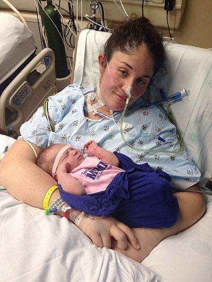 Newborn Baby wakes mother from Coma