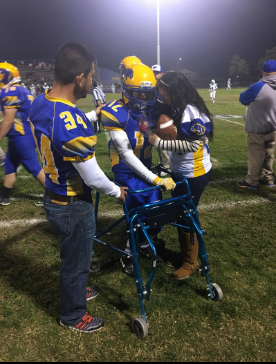 Teen with cerebral palsy scores first touchdown of the game