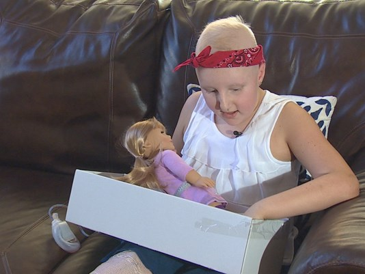 Young cancer patient receives matching doll thanks to stranger's generosity